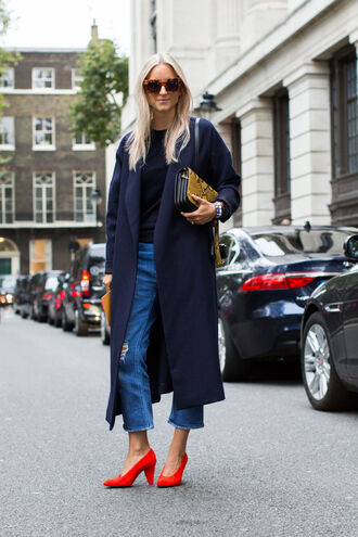 shoes fashion week street style fashion week 2016 fashion week london fashion week 2016 red shoes pumps jeans denim blue jeans ripped jeans cropped jeans coat winter coat blue coat top black top sunglasses tortoise shell tortoise shell sunglasses bag yellow bag