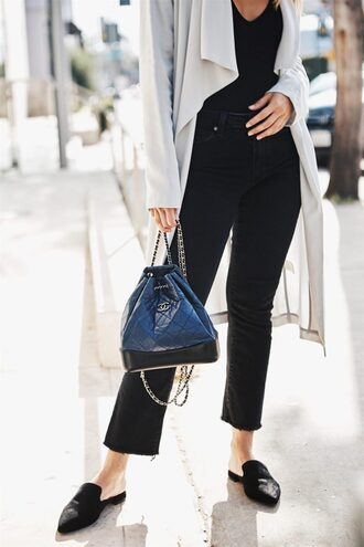 pam hetlinger the girl from panama blogger coat jeans jewels