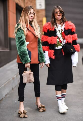 shoes nyfw 2017 fashion week 2017 fashion week streetstyle denim jeans black jeans skinny jeans cropped jeans bow shoes sneakers white sneakers socks skirt midi skirt black skirt jacket fur jacket faux fur jacket stripes striped jacket sweatshirt embroidered bag black bag furry bag