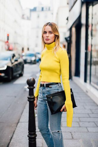 top fashion week street style fashion week 2016 fashion week paris fashion week 2016 yellow top long sleeves turtleneck cropped turtleneck belt denim jeans blue jeans ripped jeans bag black bag pouch streetstyle fall outfits