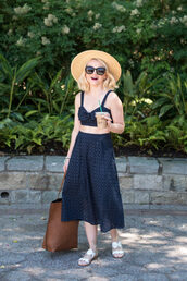 poor little it girl,blogger,shoes,skirt,sunglasses,hat,bag,jewels,eyelet detail,eyelet top,blue top,crop tops,summer outfits,summer top,bow top,black sunglasses,midi skirt,eyelet skirt,blue skirt,high waisted skirt,brown bag,straw hat,slide shoes,white shoes
