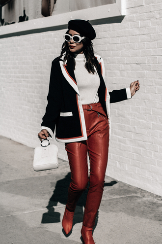 stuffshelikes blogger pants sunglasses top jacket bag shoes beret red pants red boots winter outfits