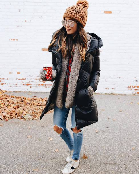 coat down jacket tumblr winter outfits winter coat black coat knitted beanie beanie pom pom beanie denim jeans blue jeans ripped jeans sneakers sunglasses