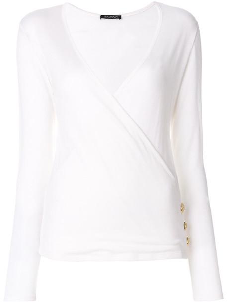Balmain - button-embellished crossover jumper - women - Silk/Wool - 36, White, Silk/Wool