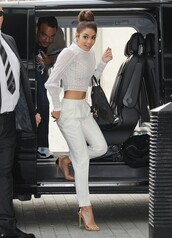 jeans,white,pants,harlem pants,white crop tops,vanessa hudgens,designer,shoes,shirt,top,blouse,two-piece,white two piece,celebrity style,crop tops,harem pants,lace,white lace top,bag,ivory,high neck,buff,crop blouse,mesh,lace top,high waisted pants,white joggers,baggy pants