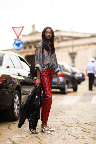 pants fashion week street style fashion week 2016 fashion week milan fashion week 2016 red pants snake print pants snake print shirt printed shirt shoes silver shoes jacket black jacket streetstyle