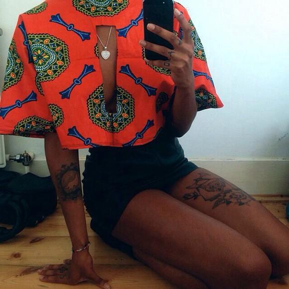 bracelets necklace top yellow blouse orange tribal pattern cleavage short sleeve neon orange tribal print top denim shorts jumpsuit