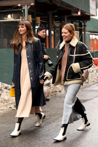 coat leather coat nyfw 2017 fashion week 2017 fashion week streetstyle navy navy coat dress nude dress midi dress tights opaque tights boots flat boots white boots skirt grey skirt slit skirt sweater printed sweater jacket black jacket shearling jacket black shearling jacket shearling black leather jacket leather jacket