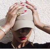 hat,dope,tumblr,nude,beige,nike cap,baseball cap,cream hat,beige cap,swag,nike,nude hat,cap,nike hat,tattoo,rihanna,red lipstick,ring,earrings