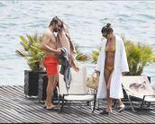 bag,irina shayk,swimwear,bikini,bikini top,bikini bottoms,flip-flops,sunglasses,beach,sea,shoes