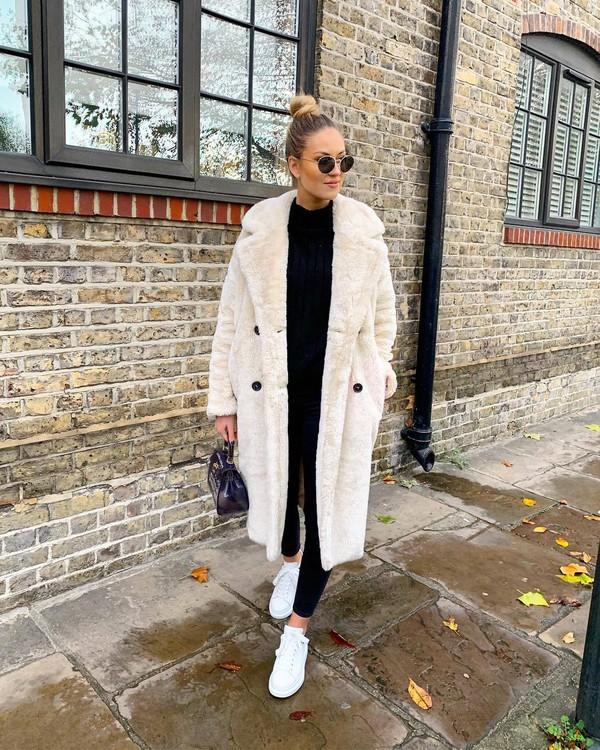 coat white coat faux fur white sneakers black pants backless sweater handbag sunglasses