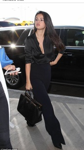 top,black top,selena gomez,singer,style,blouse,black blouse,celebrity style,pants,all black everything,plunge v neck,high waisted,wide-leg pants