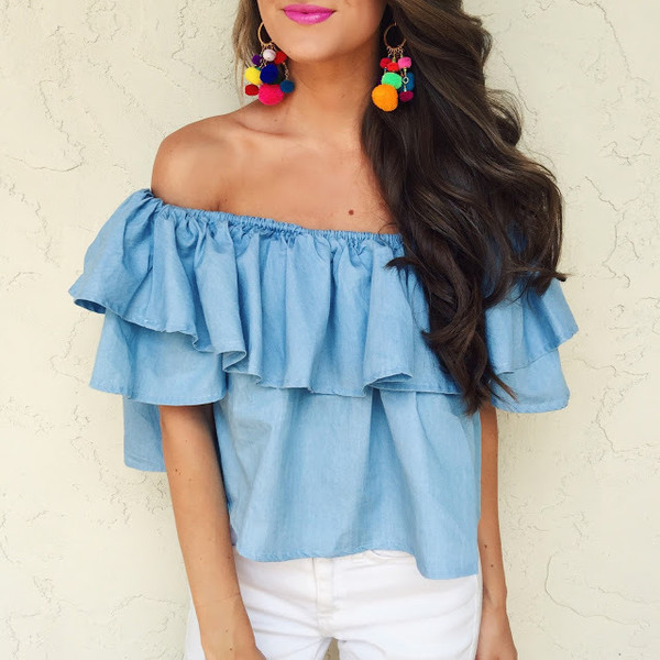 southern curls and pearls blogger jewels off the shoulder blue top denim top ruffle ruffled top white jeans summer outfits earrings blue off shoulder top off the shoulder top pom poms pompon earrings