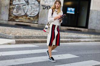 skirt fashion week street style fashion week 2016 fashion week milan fashion week 2016 midi skirt stripes striped skirt sweater nude sweater bag striped bag vans sneakers low top sneakers black sneakers streetstyle