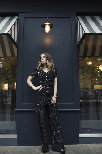 at fashion forte blogger jumpsuit jewels shoes black jumpsuit winter date night outfit stars