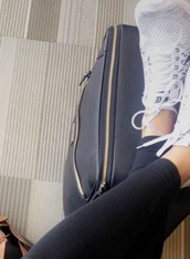 bag,black,leather,black leather,luggage,black leather luggage,vegan leather,vegan,roller skates,roller bag,carry on,suitcase,black suitcase,black leather suitcase,gold zipper,megan batoon,rolling suitcase,rolling,zip,minimalist,black minimalistic