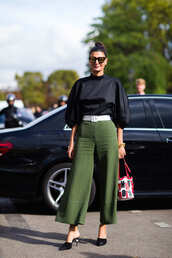 pants,fashion week street style,fashion week 2016,fashion week,paris fashion week 2016,green pants,cropped pants,top,black top,puffed sleeves,shoes,chanel shoes,chanel mules,black shoes,mules,belt,bag,sunglasses,streetstyle