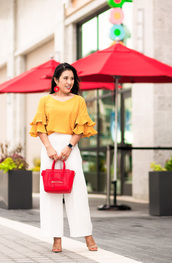 cute & little,blogger,shoes,bag,jewels,orange top,red bag,handbag,white pants,sandals,high heel sandals,summer outfits