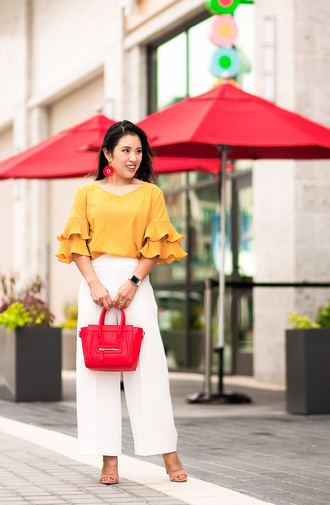 cute & little blogger shoes bag jewels orange top red bag handbag white pants sandals high heel sandals summer outfits