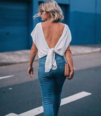 top tumblr white top open back backless top backless denim jeans blue jeans clutch