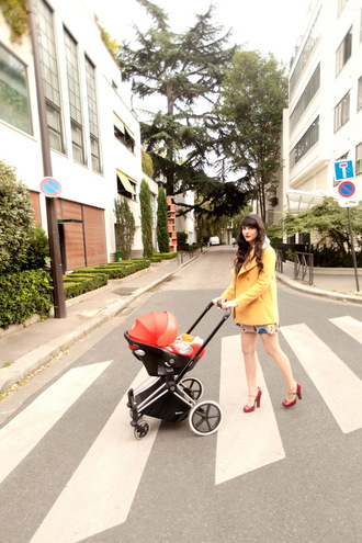 the cherry blossom girl blogger yellow coat red heels