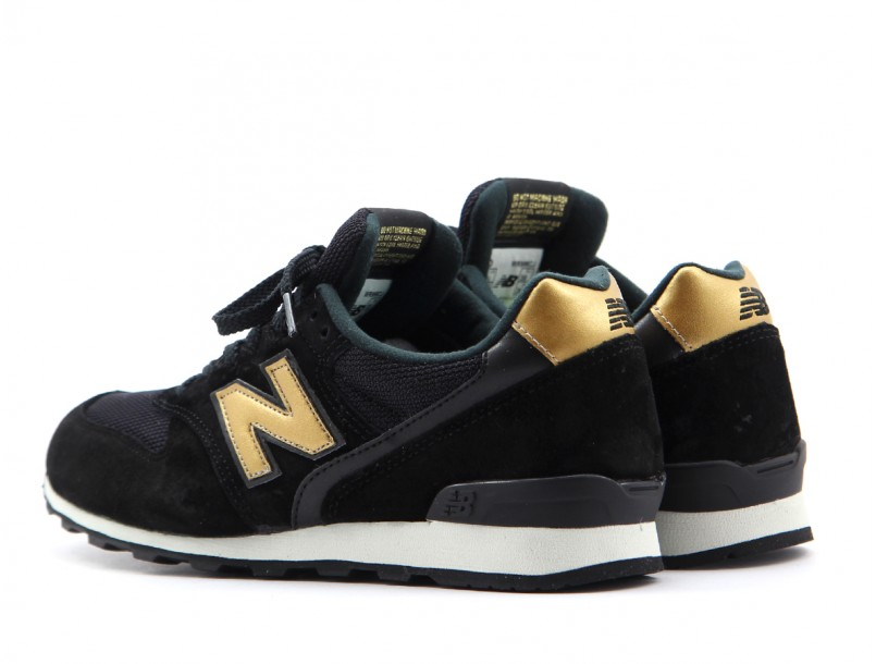 new balance 373 black and gold