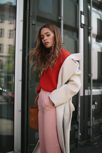 teetharejade blogger coat sweater red sweater pink pants spring outfits