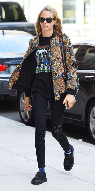 jacket top jeans cara delevingne model off-duty sunglasses bomber jacket black ripped jeans saint laurent black skinny jeans platform sneakers graphic tee tapestry