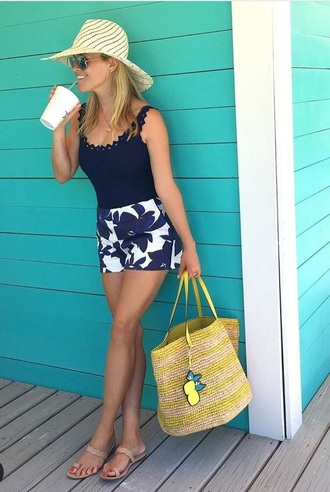 top reese witherspoon blue top tank top shorts floral blue shorts beach beach bag hat straw hat nude shoes romper flowered shorts summer shorts blue and white