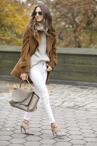 something navy blogger cropped pants white jeans studded shoes winter coat leather bag turtleneck french girl style nude sweater turtleneck sweater brown coat aviator sunglasses rayban bag nude bag