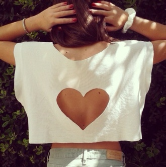 shirt tank top cutted white tank top colorful brand brandy melville celebrity style crop tops cute top topshop pattern heart cut-out white like tips high tips gorgeous white t-shirt heart cut out cool swag beautiful hipster beautyful t-shirt girly summer lovely girl blouse sweater