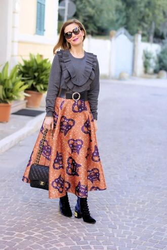 fashion and cookies blogger sunglasses top belt skirt bag shoes ruffled top spring outfits chanel bag boots midi skirt