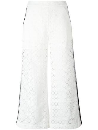 women layered white cotton pants