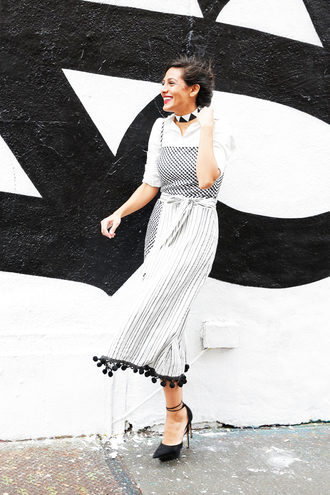 man repeller blogger top shoes pants jewels dress dress over shirt reformation reformation dress midi dress pom poms checkered dress checkered striped dress shirt white shirt dress over t-shirt pumps platform pumps black pumps spring outfits choker necklace