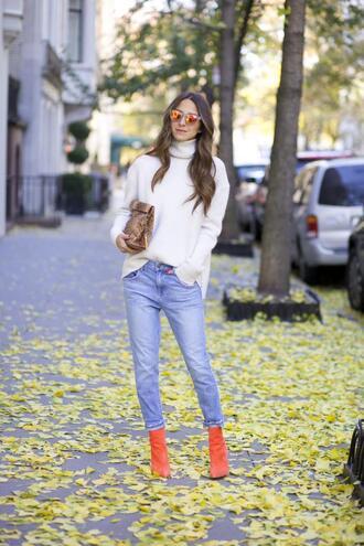 something navy blogger jeans bag sunglasses jewels orange boots snake print turtleneck