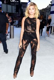 jumpsuit,pants,top,see through,hailey baldwin,vma,mtv,black,model off-duty,panties,shoes,model,celebrity,mesh,underwear,sandals,sandal heels,high heel sandals,black sandals,giuseppe zanotti,earrings,black jumpsuit