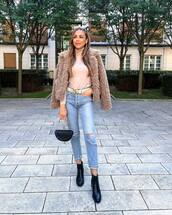 coat,faux fur coat,turtleneck,booties,skinny jeans,ripped jeans,belt,handbag