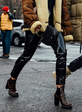 pants nyfw 2017 fashion week 2017 fashion week streetstyle black pants leather pants black leather pants vinyl black vinyl pants boots printed boots ankle boots high heels boots louis vuitton jacket shearling jacket brown shearling jacket mini bag