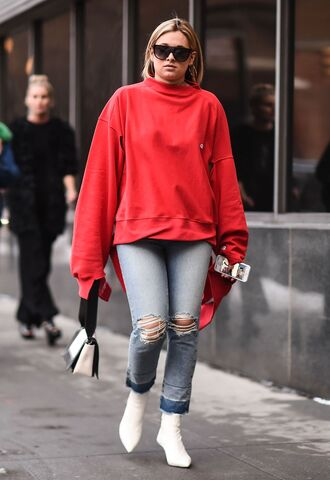 top nyfw 2017 fashion week 2017 fashion week streetstyle red top denim jeans blue jeans ripped jeans boots white boots ankle boots pointed boots bag white bag sunglasses