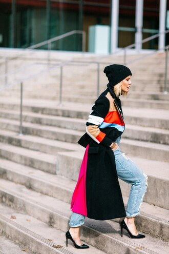 the courtney kerr blogger long coat striped coat colorblock ripped jeans winter outfits black stilettos