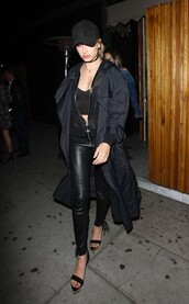 top,all black everything,hailey baldwin,sandals,cap,leather pants,coat,crop tops,choker necklace,jewels,model,model off-duty,black,jewelry,necklace,black choker,duster coat,jacket,hoodie,mesh,pants