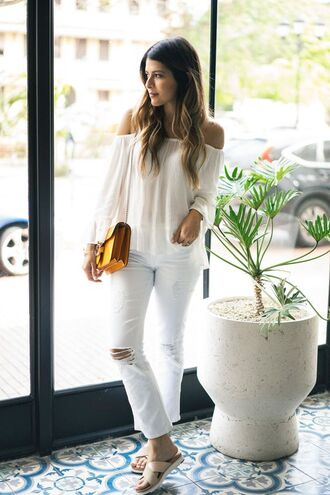 jeans cropped bootcut white jeans cropped jeans cropped bootcut jeans white ripped jeans white jeans blogger off the shoulder top off the shoulder long sleeves white top bag yellow bag shoulder bag slide shoes blouse white off shoulder top