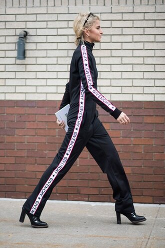 jumpsuit nyfw 2017 fashion week 2017 fashion week streetstyle black jumpsuit boots black boots high heels boots lace up boots black overalls overalls