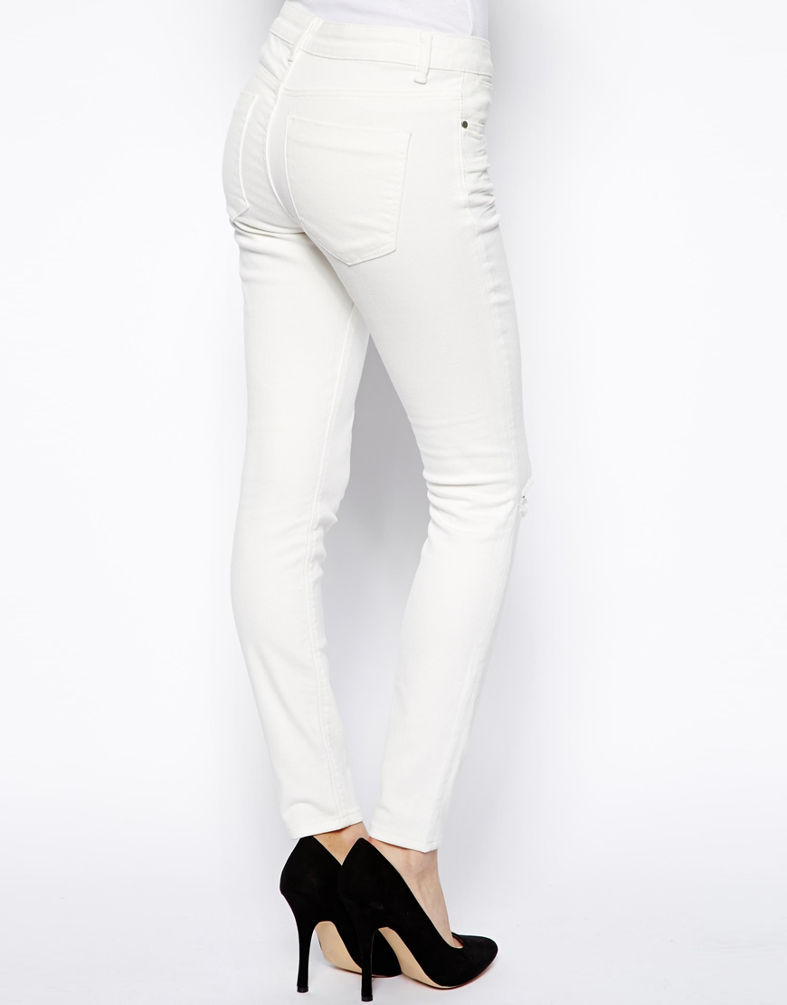 ASOS Whitby Low Rise Skinny Ankle Grazer Jeans in White with Ripped Knee at asos.com