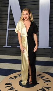 dress,gold,black,slit dress,plunge dress,miley cyrus,sandals,oscars 2018,shoes,red carpet dress