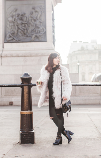 wish wish wish blogger fuzzy coat fluffy coat top jeans shoes bag white fur coat white coat fur coat winter coat black ripped jeans ripped jeans black jeans black bag high heels boots black boots winter outfits white fluffy coat