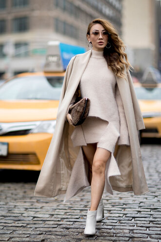 coat nyfw 2017 fashion week 2017 fashion week streetstyle nude coat long coat sweater nude sweater turtleneck turtleneck sweater mini skirt nude skirt knitted skirt knitwear boots ankle boots white boots bag brown bag furry bag sunglasses monochrome outfit