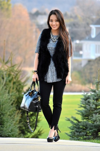 sensible stylista blogger faux fur vest black vest black fur vest top grey top statement necklace necklace pants black pants slit pants bag black bag pumps high heel pumps platform pumps