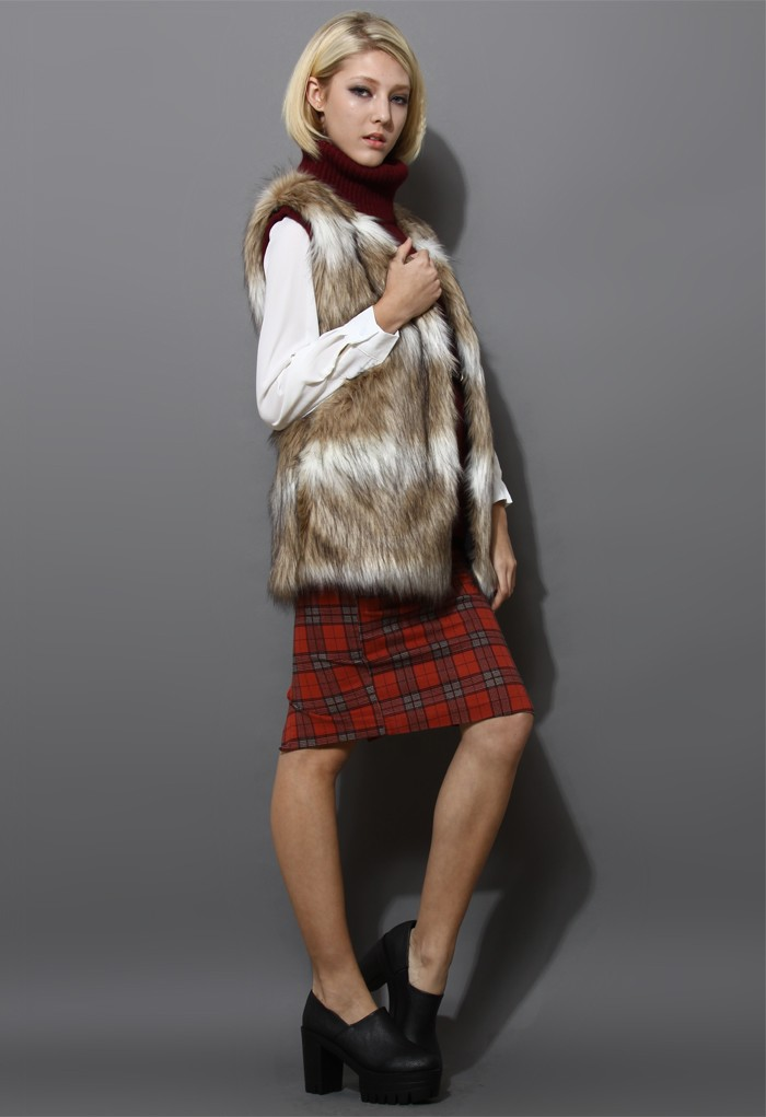Camel colored striped faux fur vest