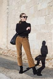 trini,blogger,sunglasses,pants,belt,shoes,bag,cropped pants,camel,camel pants,boots,black boots,top,black top,black turtleneck top,turtleneck